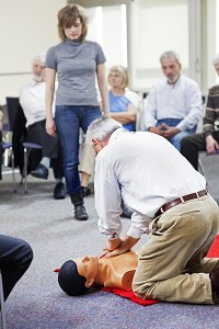 students practicing CPR on a typical dummy